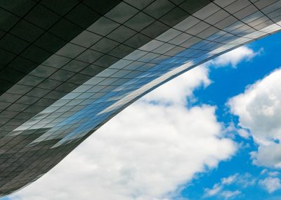 modern-architecture-roof-of-an-airport-reflecting-blue-sky-and-withe-clouds-copy-space-modern-surface_t20_dxorRj
